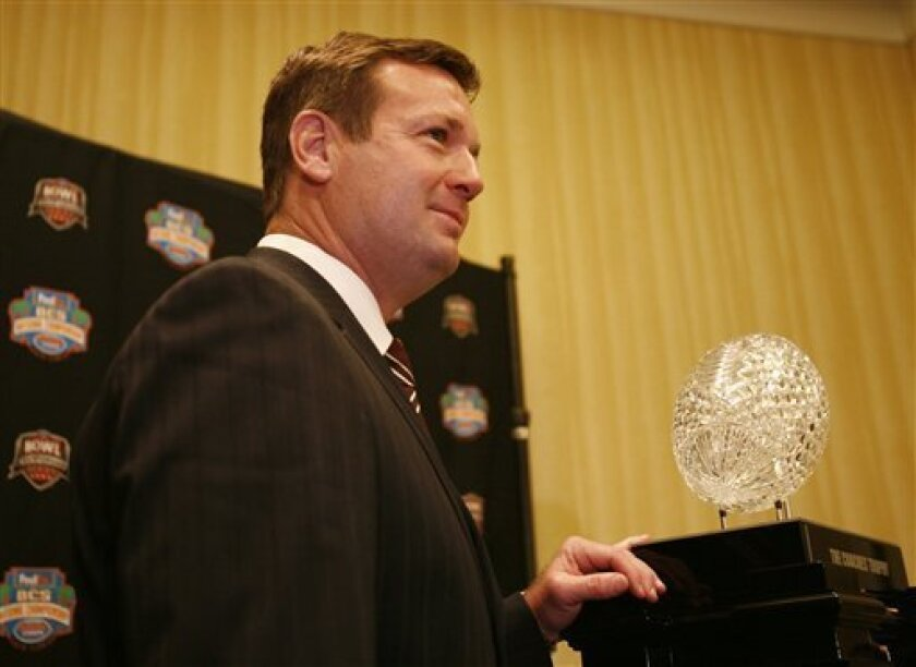 Oklahoma head coach Bob Stoops poses with the BCS championship trophy during a press conference in Ft. Lauderdale, Fla., Wednesday, Jan. 7, 2009. Oklahoma will play Florida for the NCAA BCS football championship Thursday, Jan. 8. (AP Photo/Lynne Sladky)
