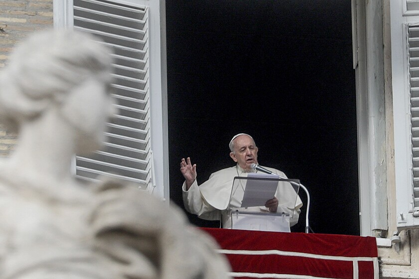Pope Francis recites a prayer from his studio window overlooking St. Peter's Square on Sunday.