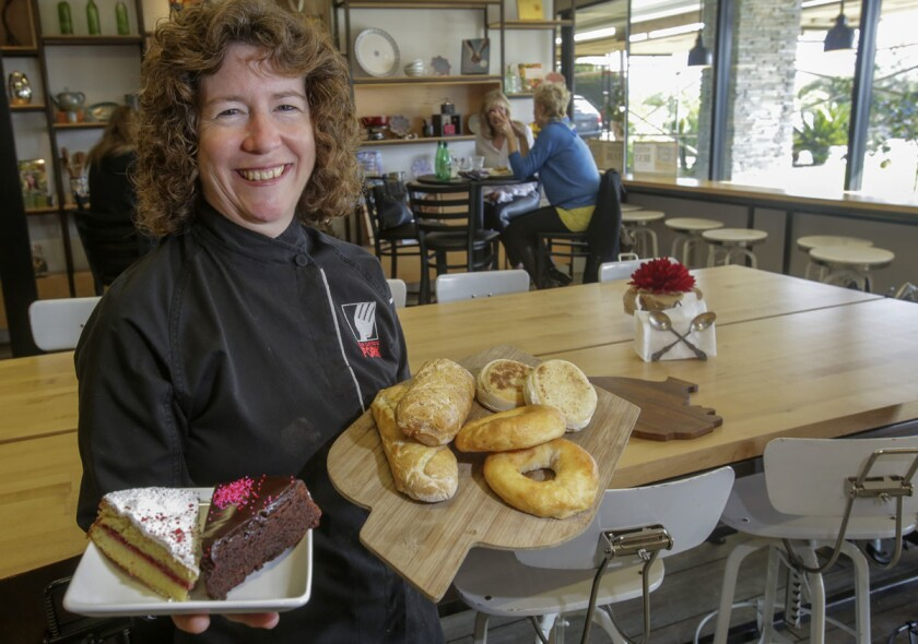 Founder/owner of The Curious Fork restaurant in Solana Beach, Barbara McQuiston, with some of the gluten-free baked goods offered at the restaurant. (Bill Wechter)
