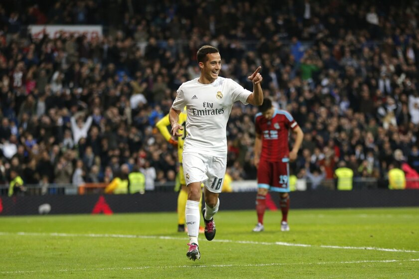 FILE - In this Wednesday, Dec. 30, 2015 filer, Real Madrid's Lucas Vazquez celebrates after scoring a goal during a Spanish La Liga soccer match between Real Madrid and Real Sociedad at the Santiago Bernabeu stadium in Madrid. Many nations are betting on youth at the European Championship, giving p