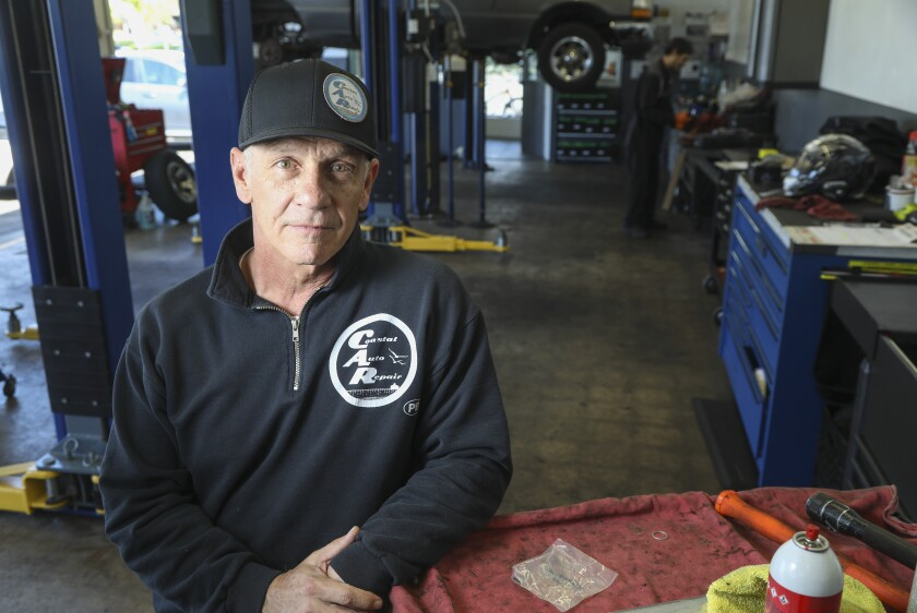 Kevin Schugar, who is a mechanic and co-owner of Coastal Auto Repair in Pacific Beach, poses for photos in the garage on April 14, 2020 in San Diego, California.