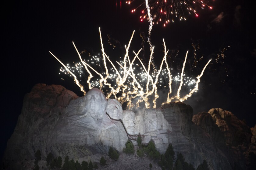 Fireworks light the sky at Mount Rushmore National Memorial, Friday, July 3, 2020. (AP Photo/Alex Brandon)