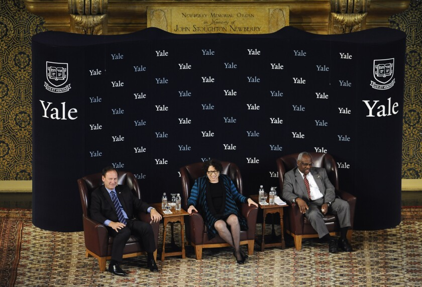 U.S. Supreme Court justices Samuel Alito, Jr., left, Sonia Sotomayor and Clarence Thomas at a conversation at Yale University, where all three attended.
