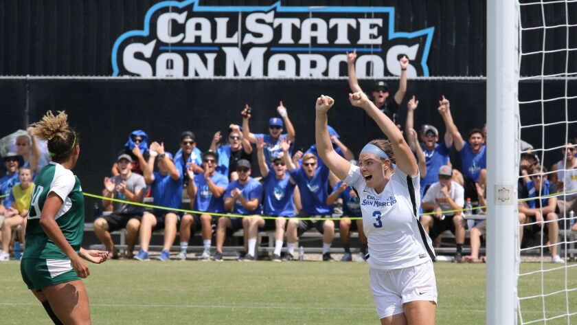 Karly Dunning, of the Cal State San Marcos Women's soccer team, celebrates her goal, the first goal of the game in her team's match against visiting Concordia University Irvine.