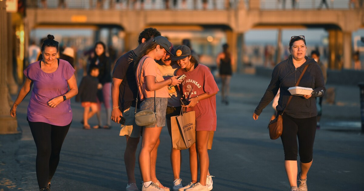 'I don't believe it': Huntington Beach a symbol of mask resistance as doubters abound