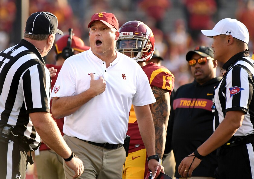 USC coach Clay Helton argues with officials Saturday during the game at the Rose Bowl.