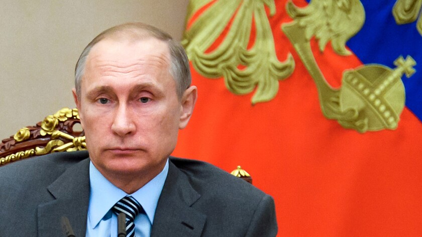 Russian President Vladimir Putin chairs a meeting of Russia's cabinet in the Kremlin in Moscow on July 22.