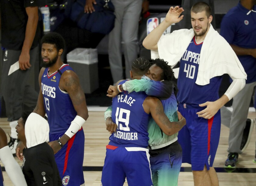 Rodney McGruder is hugged by Clippers teammate Patrick Beverley after making a three-point shot against the Trail Blazers.