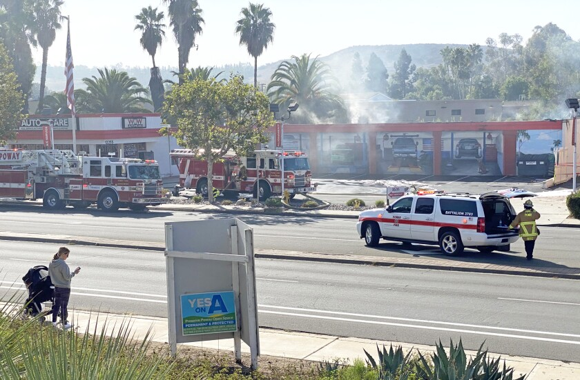Poway firefighters on the scene at Wow Auto Care on Sunday morning.