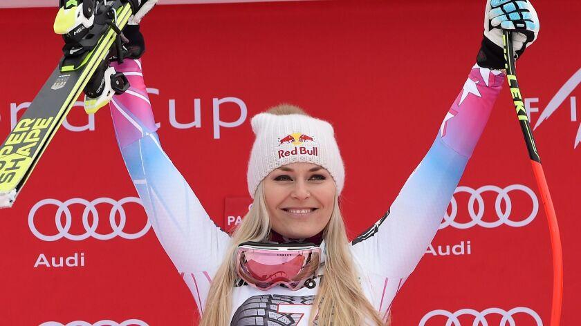 United States' Lindsey Vonn celebrates on the podium after winning an alpine ski, women's world Cup