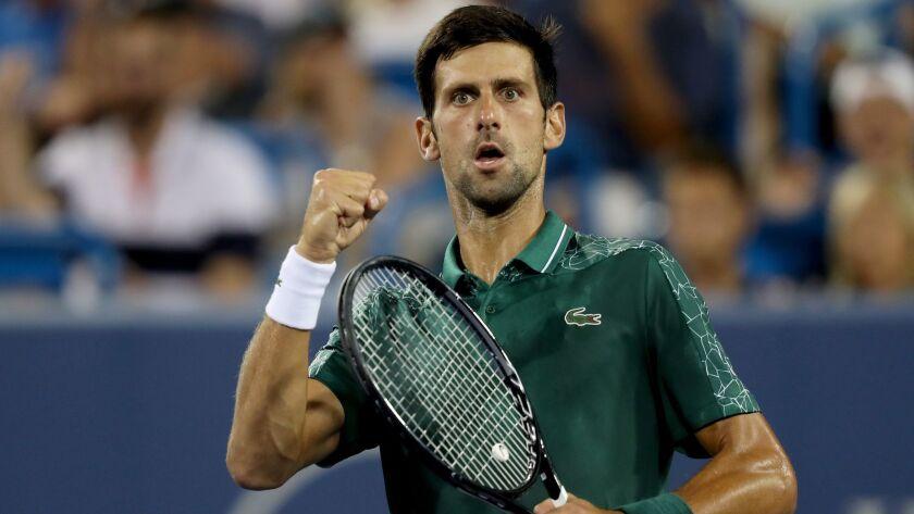 Novak Djokovic of Serbia celebrates breaking Grigor Dimitrov of Bulgaria in the second set during the Western & Southern Open.