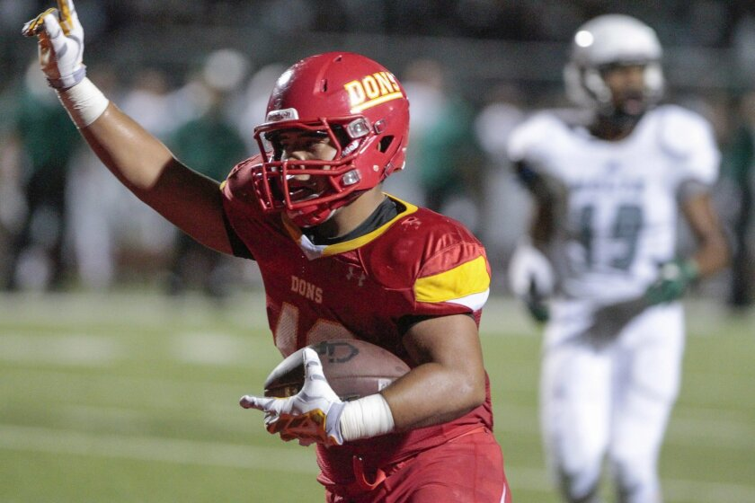 Cathedral Catholic's Kai Walter savors the score after catching a 17-yard pass for the Dons' only touchdown of the game.