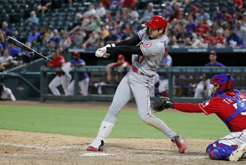Angels designated hitter Shohei Ohtani breaks his bat.