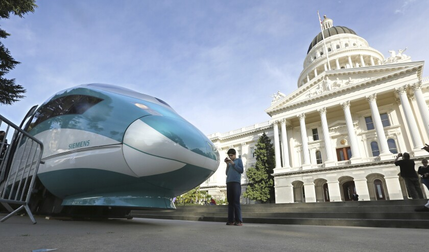 FILE - In this Feb. 26, 2015, file photo, a full-scale mock-up of a high-speed train is displayed at the Capitol in Sacramento, Calif. The federal government has reached an agreement to restore nearly $1 billion in funding for California's troubled bullet train. Gov. Gavin Newsom announced night, Thursday, June 10, 2021, that the U.S. Department of Transportation finalized settlement negotiations to restore money for the high-speed rail project that the Trump administration revoked in 2019. (AP Photo/Rich Pedroncelli, File)