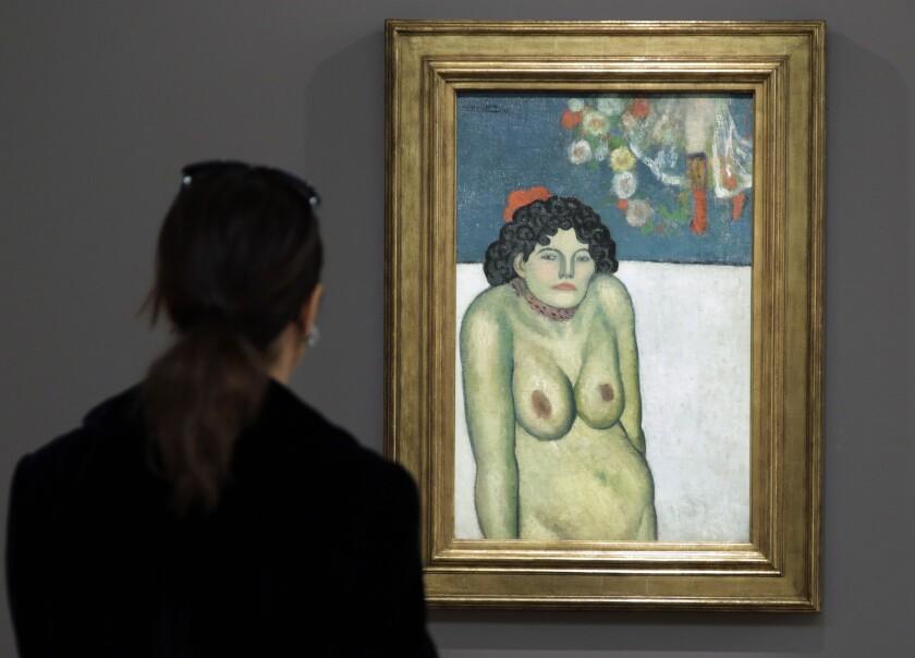 """Esta fotografía de archivo del 30 de octubre de 2015 muestra la pintura """"La Gommeuse"""", obra realizada en 1901 durante el Período Azul del pintor español Pablo Picasso, en la casa de subastas Sotheby's, en Nueva York."""