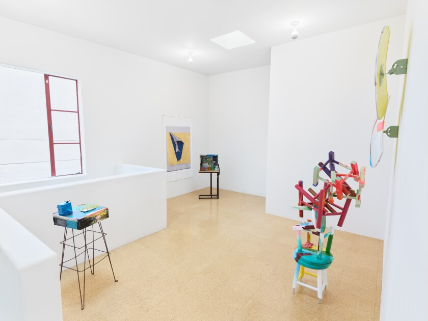 """""""Four Eyes,"""" the piece made of seven stools and two wall-mounted mirrors, right, are part of Jessica Stockholder's installation """"Digital Thoughts"""" at the Los Angeles gallery 1301PE."""