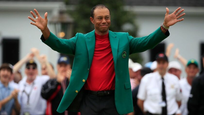 Tiger Woods celebrates after winning the Masters tournament at Augusta (Ga.) National Golf Club on Sunday.