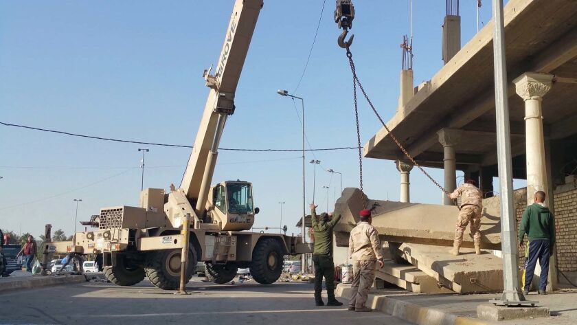 Teams of Iraqi soldiers have been removing the concrete barriers known as t-walls from around the city.