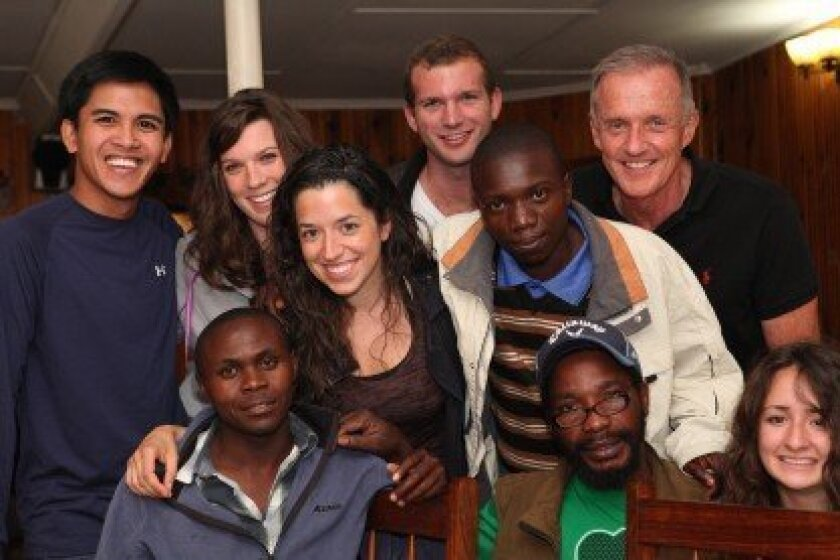 Laura Rein (second from left) and the team of dentists, students and coordinators meet for dinner Aug. 12 at the Crystal Lodge in Choma, Zambia, to discuss the Muchila project.