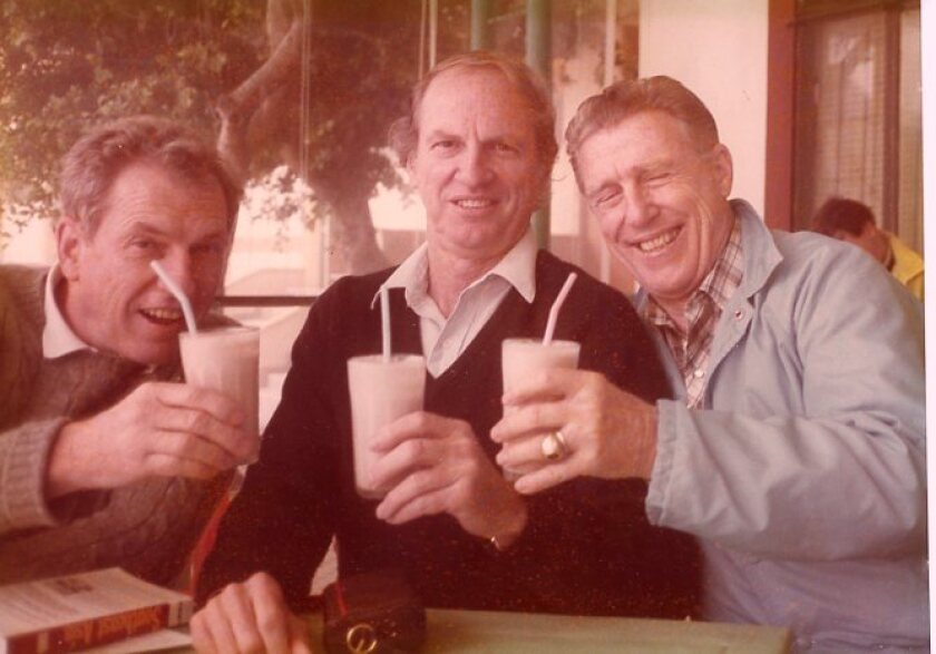 Stan, Ray and Bill toast to middle age with milkshakes.