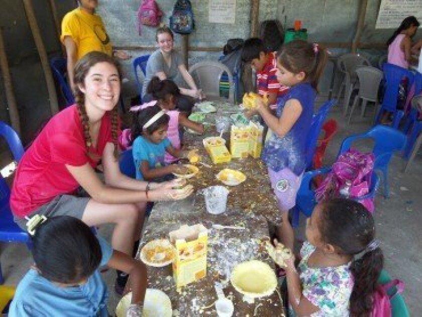 Rancho Santa Fe resident Lindsey Sanderson leads an activity at an urban youth program in El Salvador.