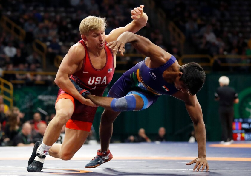 FILE - In this April 7, 2018, file photo, United State's Kyle Dake, left, takes India's Sachin Giri to the mat during their 79 kg match in the Freestyle Wrestling World Cup in Iowa City, Iowa. Dake finally broke through at age 30 at the U.S. Olympic Trials and qualified for Tokyo at 74 kilograms. (AP Photo/Charlie Neibergall, File)