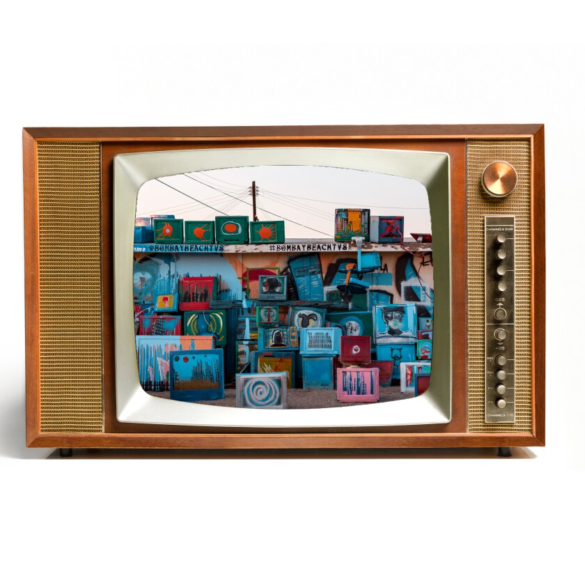 Picture of TV sets painted with scenes and stacked like an art project