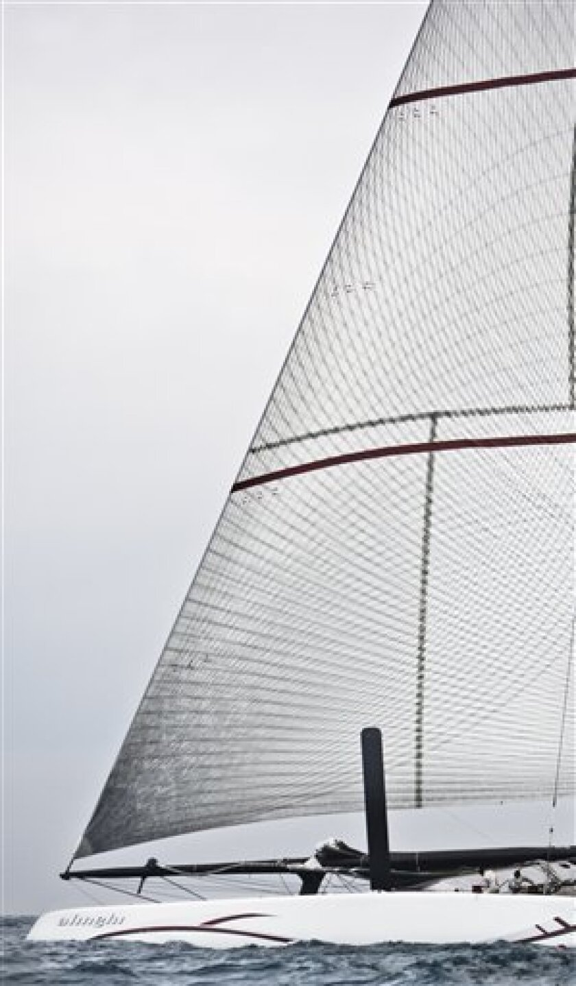 America's Cup Defender Alinghi 5 yacht sails off the coast of Valencia, Spain, on Thursday, Feb. 4, 2010. The 33rd America's Cup is scheduled to start on Feb. 8. (AP Photo/Daniel Ochoa de Olza)