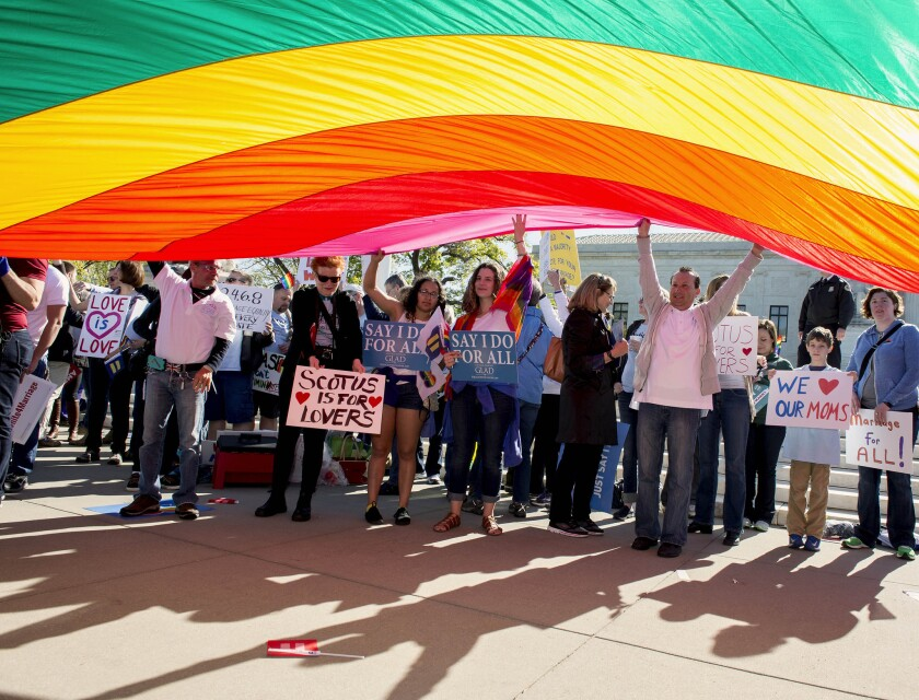 Pro and anti-gay marriage demonstrators rallied outside the U.S. Supreme Court as it heard arguments on same-sex marriage Tuesday.