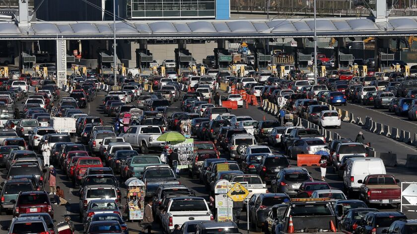 Cars wait in line to enter the United States at the San Ysidro Port of Entry on January 27, 2017 in Tijuana, Mexico.