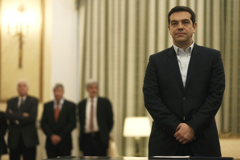 Greek Prime Minister Alexis Tsipras stands before taking a secular oath at the presidential palace in Athens on Jan. 26.