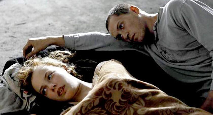 "Lore (Saskia Rosendahl) and Thomas (Kai Malina) in ""Lore."""