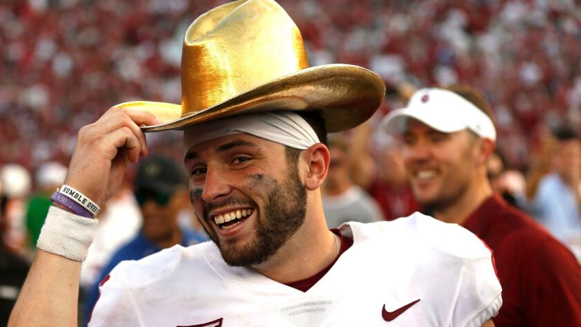 Oklahoma quarterback Baker Mayfield celebrates with the golden hat trophy following the Sooners' 29-24 win over Texas in the annual Red River Rivalry game on Oct. 14.