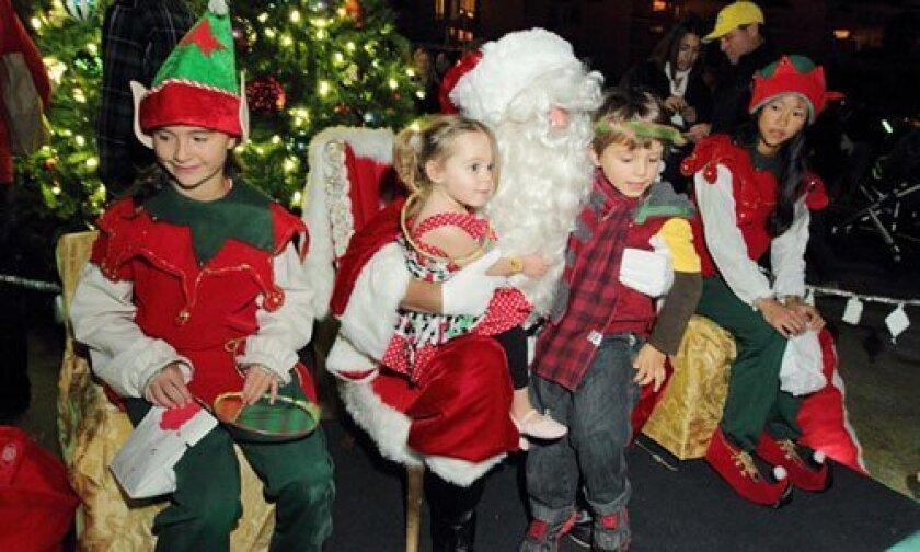 Renie and Aiden Schnurer visit with Santa