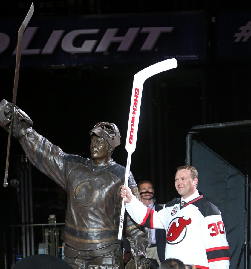 Martin Brodeur waves as he leaves the ice at the conclusion of the ceremony to retire the number he used as New Jersey Devils goaltender, in Newark, N.J., Tuesday, Feb. 9, 2016. (Chris Pedota/The Record of Bergen County via AP) MANDATORY CREDIT