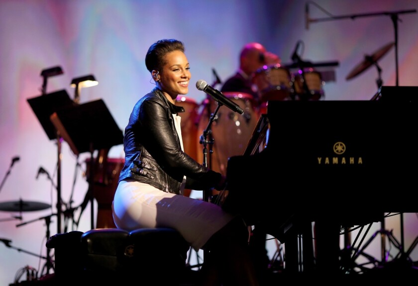 Singer Alicia Keys performs onstage at 2014 MusiCares Person Of The Year Honoring Carole King at Los Angeles Convention Center on Jan. 24, 2014.