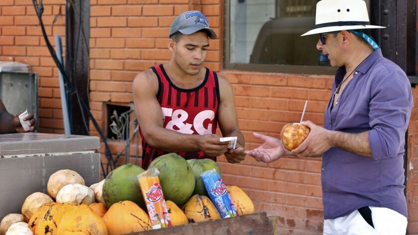 A man sells cocos to tourists in Havana on July 14, 2018.