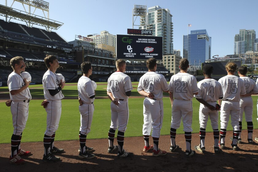 Classical Academy players stand during the national anthem before playing Orange Glen at Petco Park on Friday. Classical defeated Orange Glen 12-0. There are three more high school baseball games at Petco Park on Saturday: El Capitan vs. Valhalla, 10 a.m. Holtville vs. Imperial, 1 p.m. Olympian vs. Otay Ranch, 4 p.m.