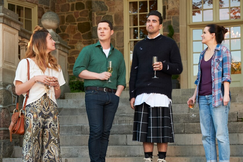 """Annie Murphy, left, Noah Reid, Dan Levy and Emily Hampshire in """"Schitt's Creek,"""" one of a spate of TV series to integrate queer themes into family comedy or drama."""