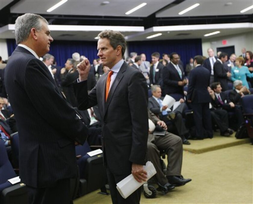Transportation Secretary Ray LaHood, left, talks Treasury Secretary Tim Geithner before the start of President Obama's jobs summit, officially known as the Jobs and Economic Growth Forum, Thursday, Dec. 3, 2009, in the Eisenhower Executive Office Building on the White House campus in Washington. (AP Photo/J. Scott Applewhite)