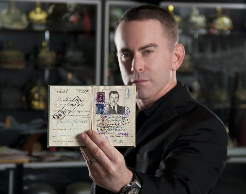Military artifacts expert Craig Gottlieb, 42, holds the passport issued to Nazi war criminal Josef Mengele in 1949. He purchased the document a few months ago and would like to donate it to a Holocaust museum in the United States or Israel.