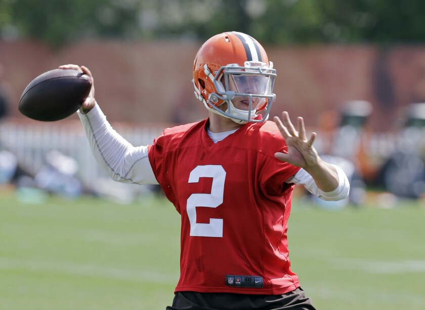 Cleveland Browns quarterback Johnny Manziel passes during a practice on Wednesday.