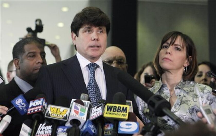 "FILE - In this Aug. 17, 2010 file photo, former Illinois Gov. Rod Blagojevich, with his wife, Patti, listening at right, talks to the media at the federal building in Chicago after a jury found him guilty on one count of lying to federal agents and were deadlocked on 23 other charges. In the Bonds case in San Francisco, Judge Susan Illston ruled that she would keep the jurors' names secret until after their verdict on whether the homerun king lied to a grand jury about taking performance-enhancing drugs. Illston cited the decision by federal Judge James Zagel in Chicago last year to withhold the names of the Blagojevich jurors to protect them from media ""harassment.""(AP Photo/Kiichiro Sato, File)"