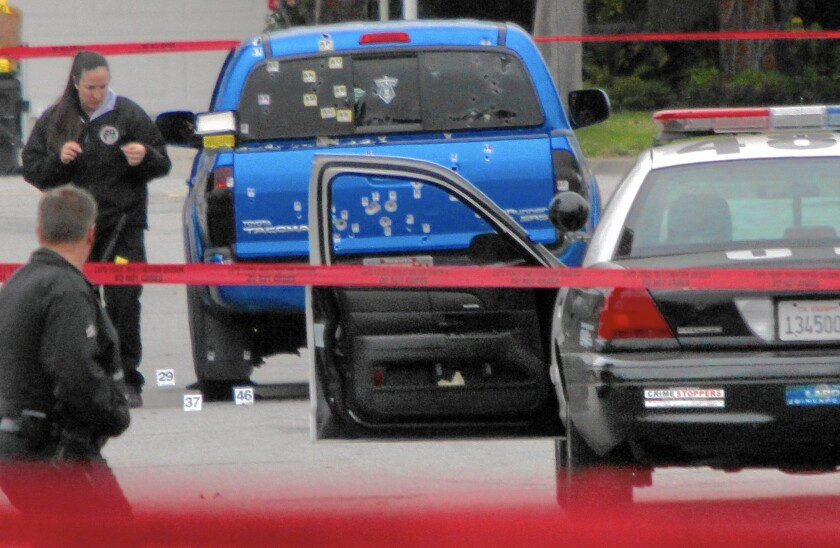 Police inspect a pickup riddled with bullets in Torrance on Feb. 7, 2013. Two women in the truck delivering newspapers were mistaken for Christopher Dorner, a rogue former cop.