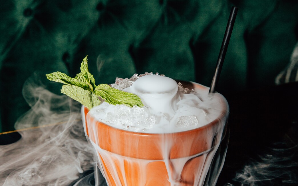 The Smoking Pot cocktail from V DTLA bar and restaurant in downtown L.A. is served in a clay pot with dry ice.