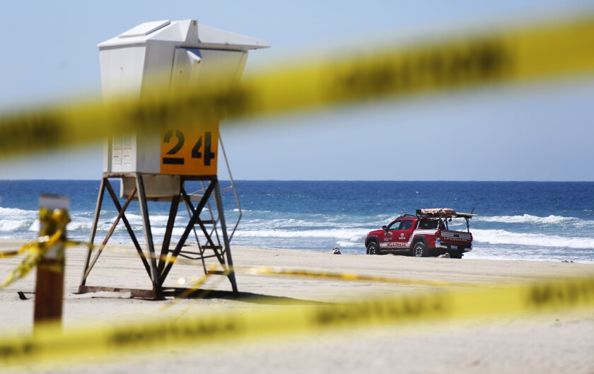 A San Diego Lifeguard patrols a closed Pacific Beach on March 30, 2020. San Diego beaches, parks and trails were closed due to the coronavirus.