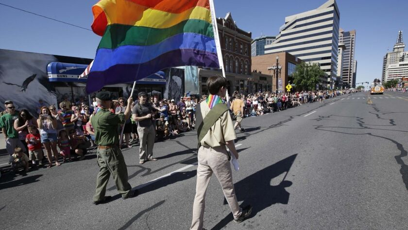 FILE - In this June 8, 2014, file photo, a group of Boy Scouts march during the Salt Lake City's ann