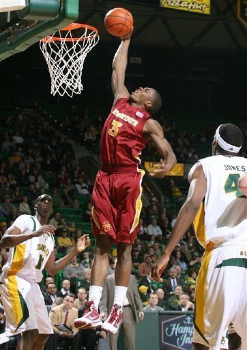 Iowa State's Jamie Vanderbeken (23) scores against Baylor defenders Ekpe Uhdo, left, and Anthony Jones, right, in the first half of an NCAA college basketball game Wednesday, Feb. 3, 2010, in Waco, Texas. (AP Photo/Jerry Larson)