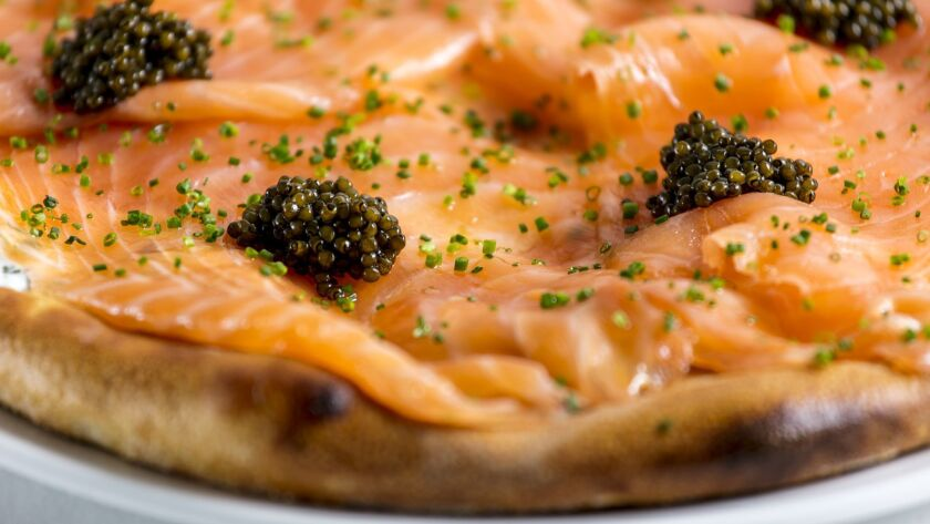 BEVERLY HILLS, CALIFORNIA - June 19, 2019: Spago's popular pizza with house-cured smoked salmon, re