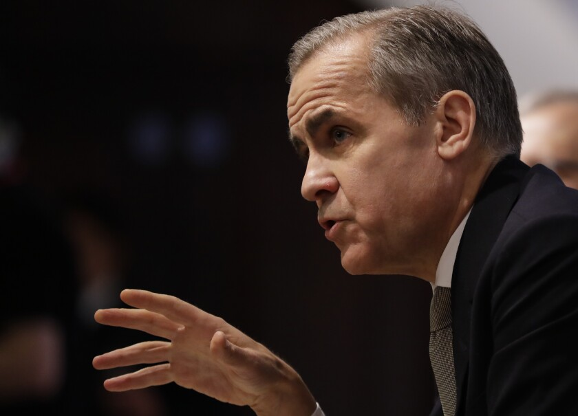 Mark Carney, Governor of the Bank of England speaks at a Bank of England Financial Stability Report Press Conference, in London, Monday, Dec. 16, 2019. (AP Photo/Kirsty Wigglesworth,pool)